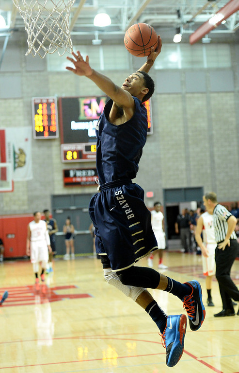 . St. John Bosco\'s Tyler Dorsey goes to the basket after a call, stopping the play, in a Trinity League boy\'s basketball game at Mater Dei High School in Santa Ana, CA. on Wednesday, January 15, 2014. (Photo by Sean Hiller/ Daily Breeze).