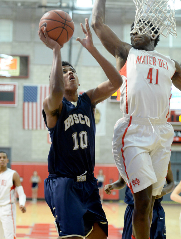 . St. John Bosco\'s Vance Jackson, right, battles Mater Dei\'s IStanley Johnson in a Trinity League boy\'s basketball game at Mater Dei High School in Santa Ana, CA. on Wednesday, January 15, 2014. (Photo by Sean Hiller/ Daily Breeze).