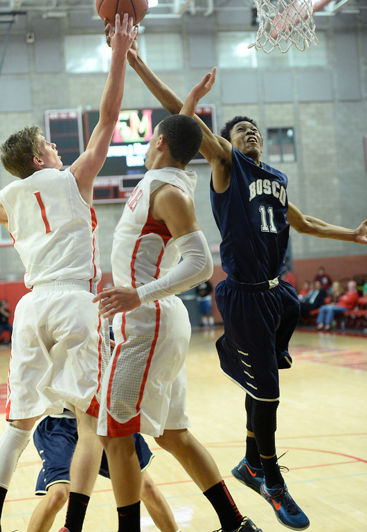 . St. John Bosco\'s Rodney Henderson goes for a rebound against  Mater Dei\'s Rex Pflueger, left, in a Trinity League boy\'s basketball game at Mater Dei High School in Santa Ana, CA. on Wednesday, January 15, 2014. (Photo by Sean Hiller/ Daily Breeze).