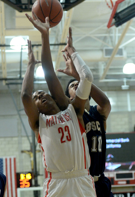 . St. John Bosco\'s Vance Jackson, right, battles Mater Dei\'s Isaiah Juarez in a Trinity League boy\'s basketball game at Mater Dei High School in Santa Ana, CA. on Wednesday, January 15, 2014. (Photo by Sean Hiller/ Daily Breeze).