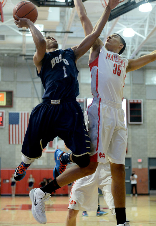 . St. John Bosco\'s Tyler Dorsey goes to the basket against  Mater Dei\'s M.J. Cage in a Trinity League boy\'s basketball game at Mater Dei High School in Santa Ana, CA. on Wednesday, January 15, 2014. (Photo by Sean Hiller/ Daily Breeze).