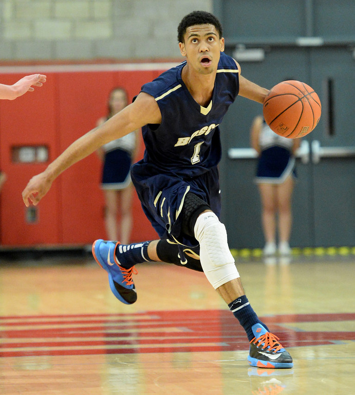 . St. John Bosco\'s Tyler Dorsey drives against Mater Dei in a Trinity League boy\'s basketball game at Mater Dei High School in Santa Ana, CA. on Wednesday, January 15, 2014. (Photo by Sean Hiller/ Daily Breeze).