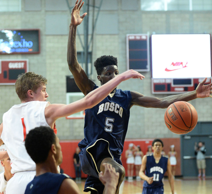 . St. John Bosco\'s Daniel Hamilton is blocked by Mater Dei\'s Rex Pflueger in a Trinity League boy\'s basketball game at Mater Dei High School in Santa Ana, CA. on Wednesday, January 15, 2014. (Photo by Sean Hiller/ Daily Breeze).