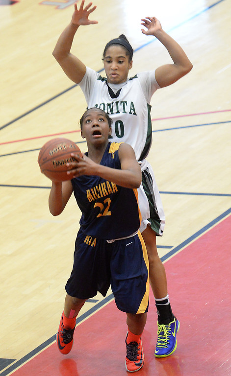 . Millikan\'s Kamila Auls (22) goes to the basket against  Bonita\'s Nikki Wheatley in the  56-53 win in the CIF Southern Section Division 1-AA girls basketball final at Azusa Pacific University in Azusa, CA. on Saturday March 8, 2014. (Photo by Sean Hiller/ Daily Breeze).