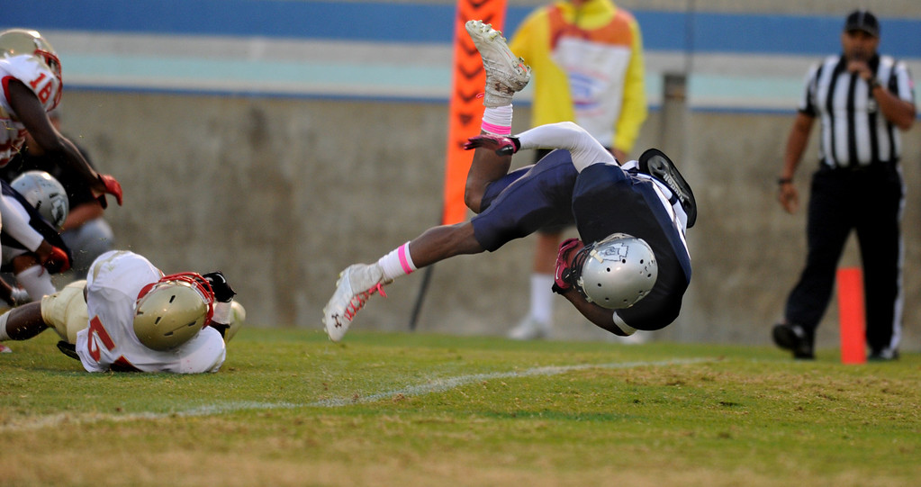 . El Camino\'s Raphael Lawson-Gayle flips into the end zone for a touchdown against  Desert College\'s Derrick Nealy in the North Central Conference football game at Murdock Stadium in Torrance, CA. on Saturday, October 26, 2013. (Photo by Sean Hiller/ Daily Breeze)
