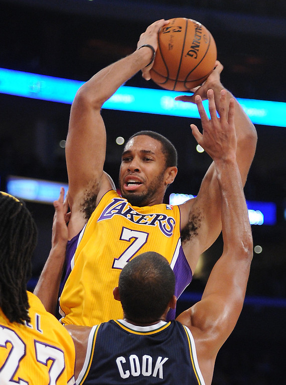 . Los Angeles Laker Xavier Henry goes against the Utah Jazz\'s Brian Cook in the NBA preseason basketball game at Staples Center in Los Angeles, CA. on Tuesday, October 22, 2013. (Photo by Sean Hiller/Daily News)