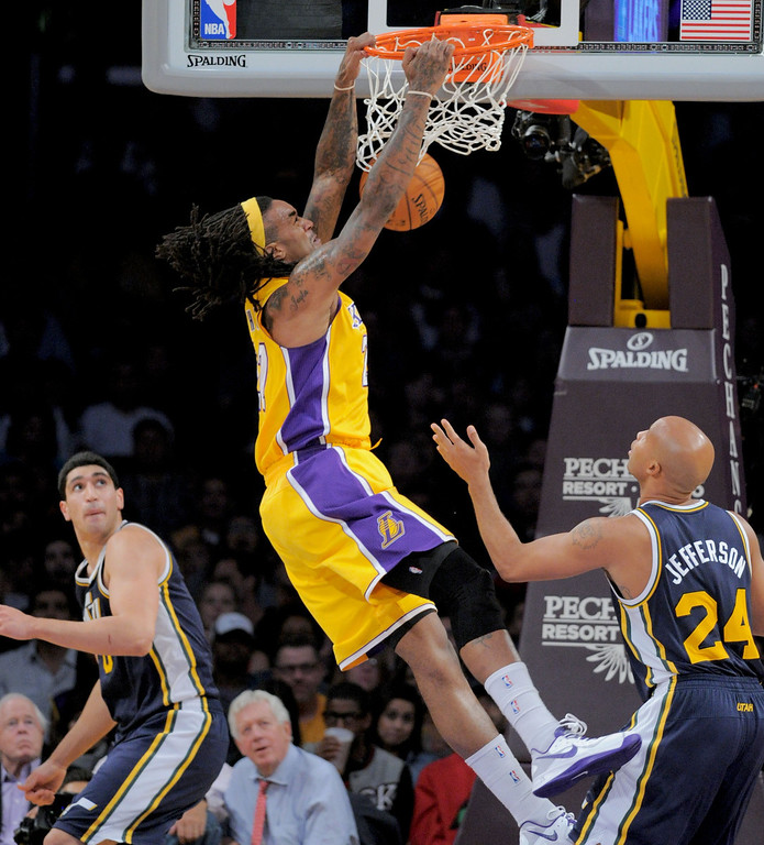 . Los Angeles Laker Jordan Hill dunks over Utah Jazz\'s Enes Kanter,left, and Richard Jefferson first half in the NBA preseason basketball game at Staples Center in Los Angeles, CA. on Tuesday, October 22, 2013. (Photo by Sean Hiller/Daily News)