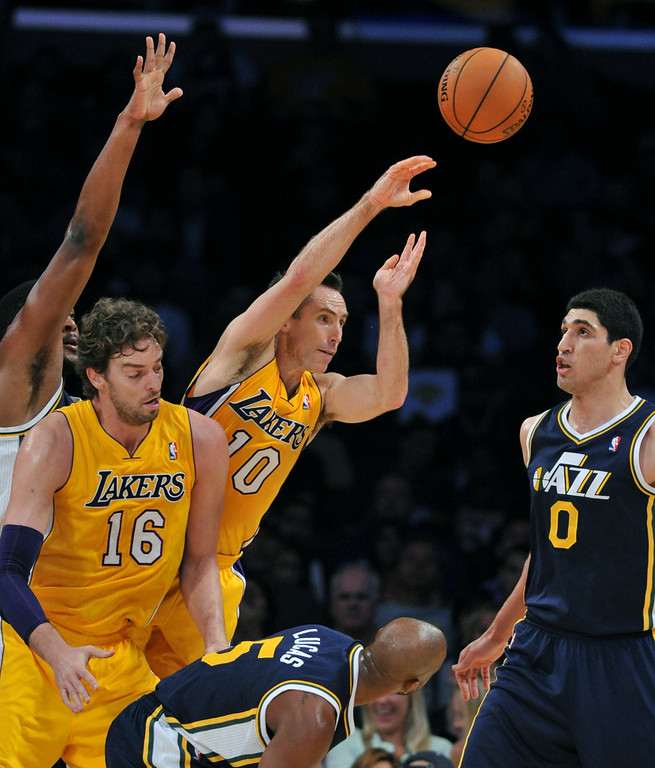 . Los Angeles Laker Steve Nash move the ball to the outside over Utah Jazz\'s Enes Kanter in the NBA preseason basketball game at Staples Center in Los Angeles, CA. on Tuesday, October 22, 2013. (Photo by Sean Hiller/Daily News)