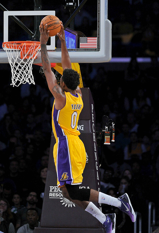 . Los Angeles Laker Nick Young dunks against the Utah Jazz in the NBA preseason basketball game at Staples Center in Los Angeles, CA. on Tuesday, October 22, 2013. (Photo by Sean Hiller/Daily News)