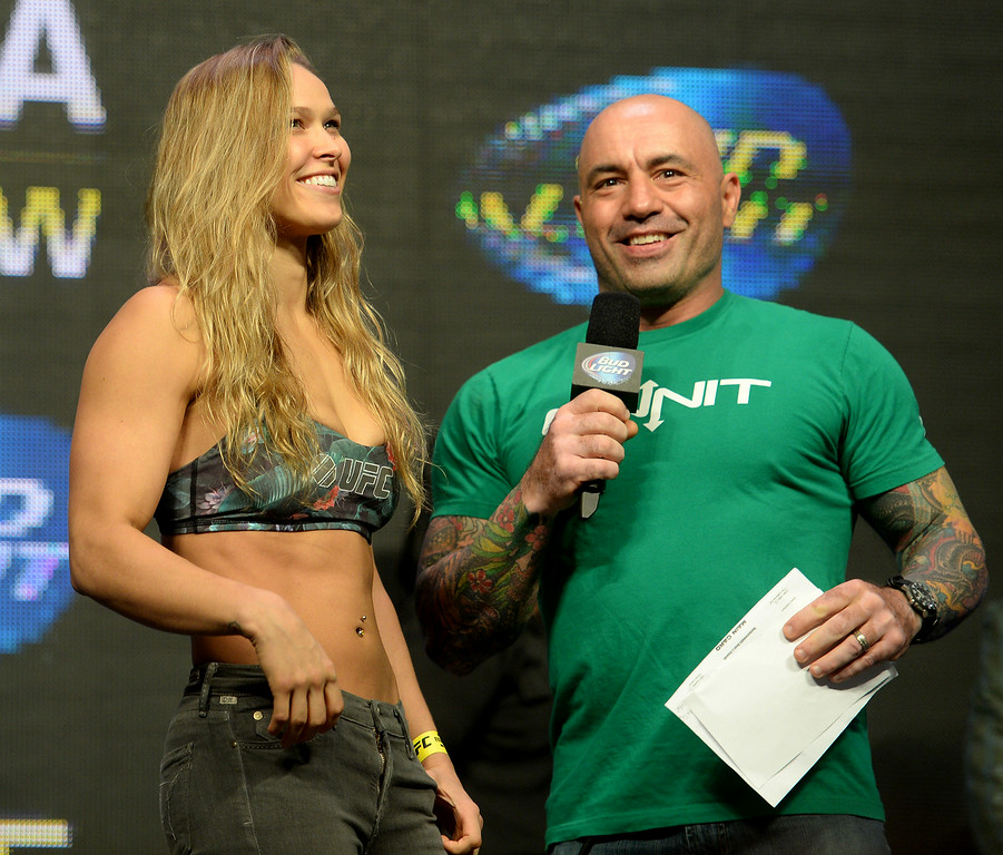 . UFC Women\'s Bantamweight Champion Ronda Rousey talks with commentator Joe Rogan during weigh-ins for UFC 175 at the Mandalay Bay Events Center July 4, 2014. (Photo by Hans Gutknecht/Los Angeles Daily News)