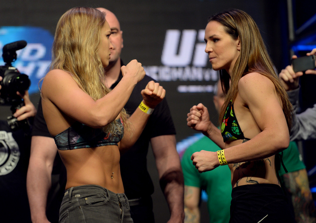 . UFC Women\'s Bantamweight Champion Ronda Rousey and challenger Alexis Davis during weigh-ins for UFC 175 at the Mandalay Bay Events Center July 4, 2014. (Photo by Hans Gutknecht/Los Angeles Daily News)