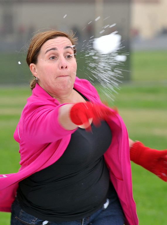 . Physical education teacher Mrs. Barker, throws a snowball at Bethany Lutheran School where 10 tons of snow was delivered Thursday to  thank students for a successful jog-a-thon.  Long Beach January 30, 2014. (Photo by Brittany Murray / Press Telegram)