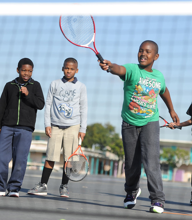 . Dajon Hancox practices his swing at Leapwood Elementary Wednesday as part of an outreach program by a local tennis academy Ramp Tennis in Carson , CA. on Wednesday, February 05, 2014. (Photo by Sean Hiller/ Daily Breeze).