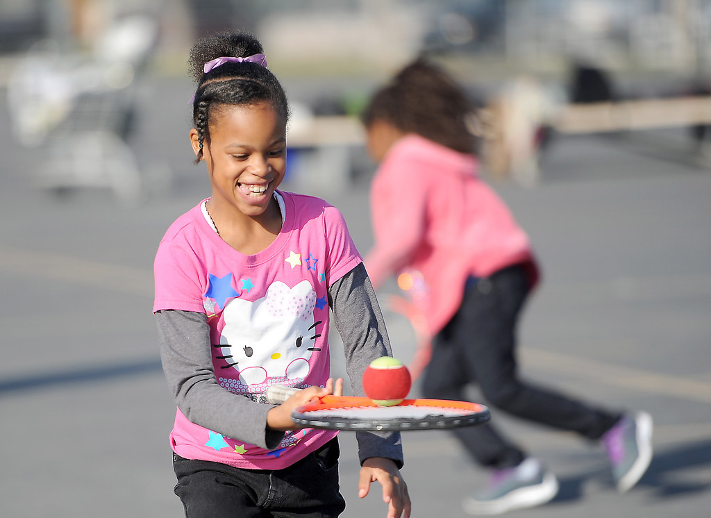 . Miauni Humphrey keeps a ball balanced during a relay at Leapwood Elementary Wednesday as part of an outreach program by a local tennis academy Ramp Tennis in Carson , CA. on Wednesday, February 05, 2014. (Photo by Sean Hiller/ Daily Breeze).