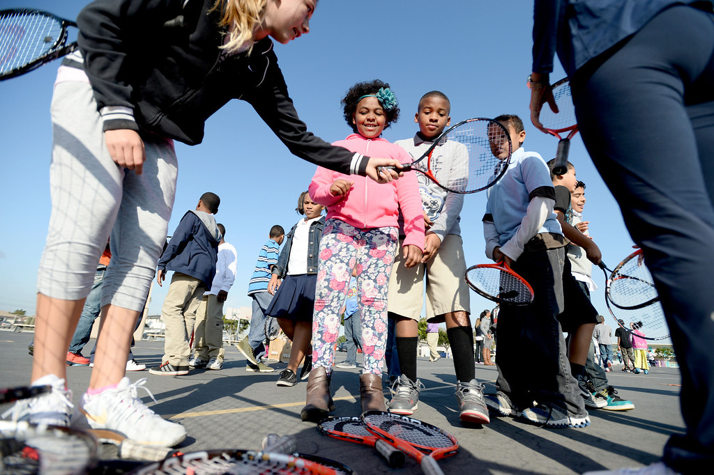 . Students at Leapwood Elementary get tennis lessons Wednesday as part of an outreach program by a local tennis academy Ramp Tennis in Carson , CA. on Wednesday, February 05, 2014. (Photo by Sean Hiller/ Daily Breeze).
