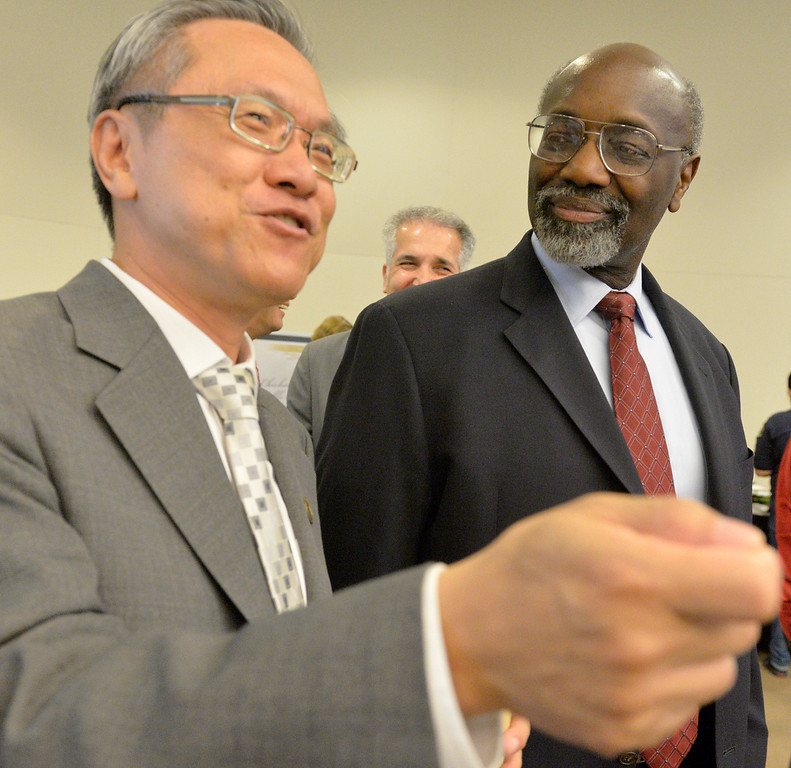 . Interim Cal State Dominguez Hills president, Willie Hagan, right, talks to Dean Joseph Wen, College of Business Administration and Public Policy, at a campus brunch at the Loker Student Union in Carson, CA. Thursday May 1, 2014. Hagan will be inaugurated as the university\'s 10th president. (Thomas R. Cordova-Daily Breeze/Press-Telegram)