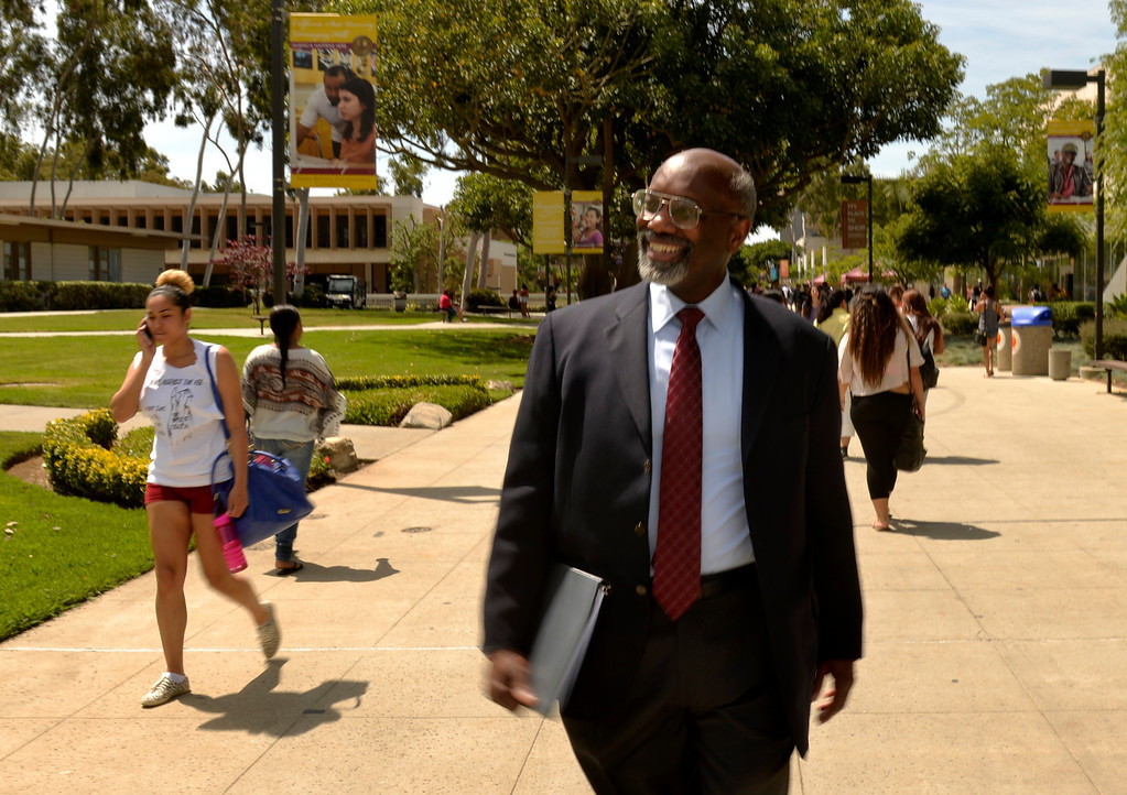 . Interim Cal State Dominguez Hills president, Willie Hagan, takes a short walk before a campus brunch around the Loker Student Union at the university in Carson, CA. Thursday May 1, 2014. Hagan will be inaugurated as the university\'s 10th president. (Thomas R. Cordova-Daily Breeze/Press-Telegram)