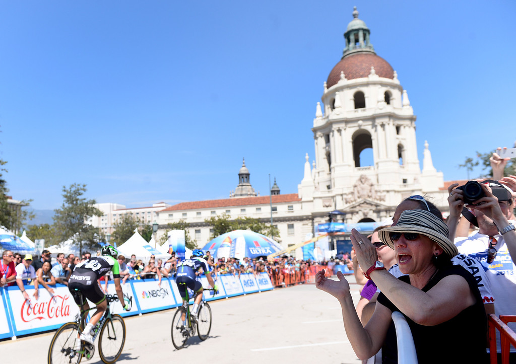 . The crowd cheers the stage 7 leaders of the Amgen Tour of California as they make their final laps in Pasadena Saturday, May 17, 2014. (Photo by Sarah Reingewirtz/Pasadena Star-News)