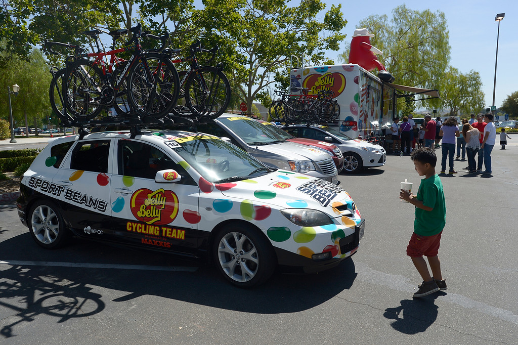 . A young man gets a look at the Jelly Belly team car. The Amgen Tour of California stage 7 started at the Town Center Mall in Valencia. The 88.7 mile trek took a serpentine route through the Angeles National Forest before ending in Pasadena. Valencia, CA. 5/17/2014(Photo by John McCoy / Los Angeles Daily News)