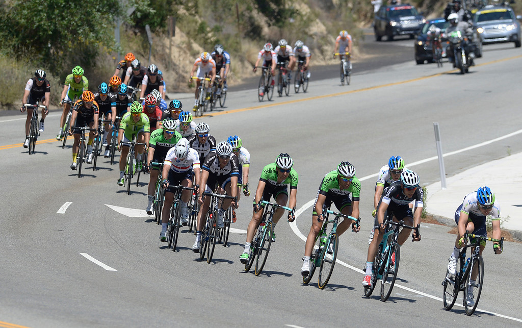 . Riders make their way down Angeles Crest Highway entering La Canada Flintridge.  The Amgen Tour of California stage 7 started at the Town Center Mall in Valencia. The 88.7 mile trek took a serpentine route through the Angeles National Forest before ending in Pasadena. La Canada Flintridge, CA. 5/17/2014(Photo by John McCoy / Los Angeles Daily News)