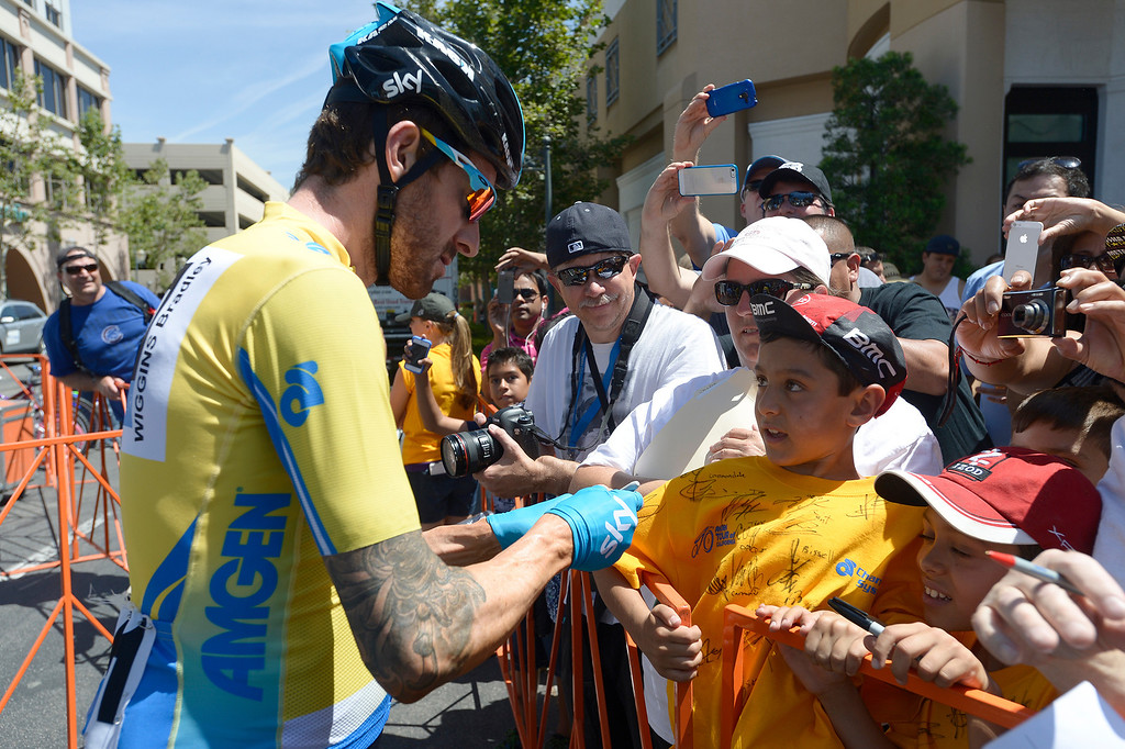 . Bradley Wiggins signs the shirt of Eli Spotts,8. The Amgen Tour of California stage 7 started at the Town Center Mall in Valencia. The 88.7 mile trek took a serpentine route through the Angeles National Forest before ending in Pasadena. Valencia, CA. 5/17/2014(Photo by John McCoy / Los Angeles Daily News)