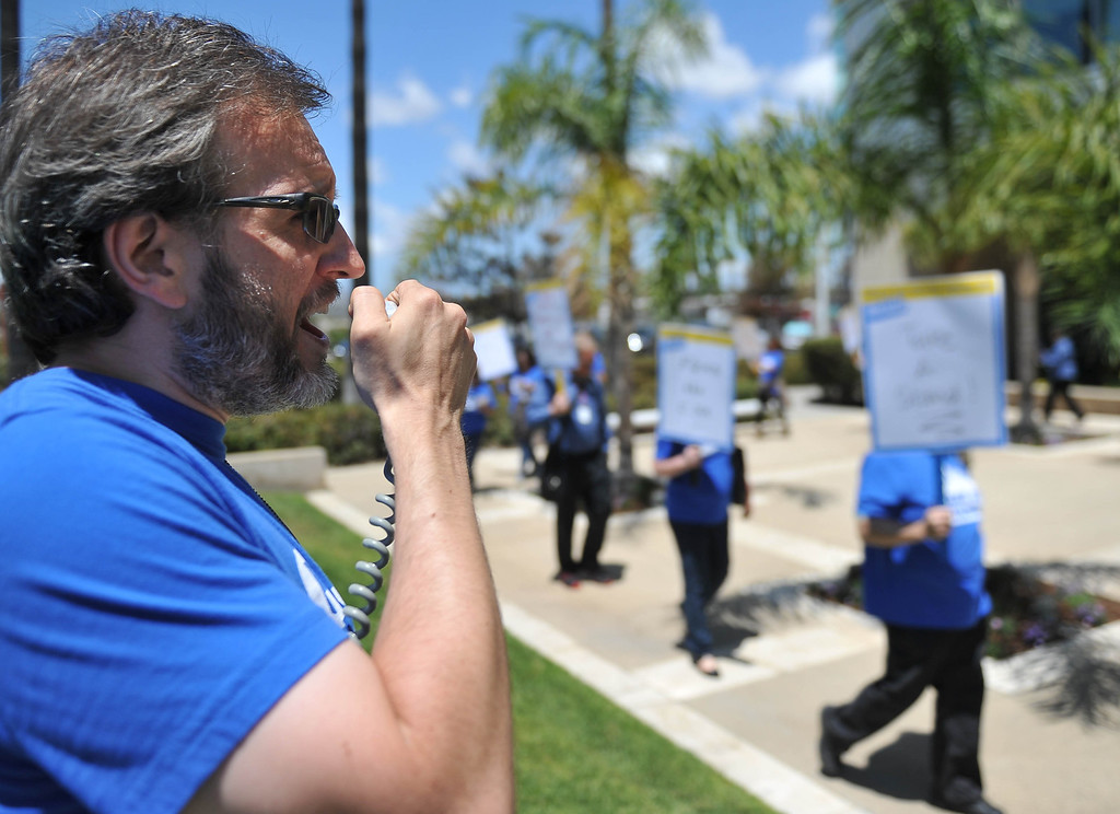 . Joseph Dobzynski, Jr. Vice President & Chief Steward for  California State University Employees Union (CSUEU) leads members in a protest rally at the CSU Office of the Chancellor. The coalition is calling on CSU management take action to retain experienced employees as it finalizes its 2014-15 budget, among other concerns.  Long Beach May 20, 2014. (Photo by Brittany Murray / Daily Breeze)