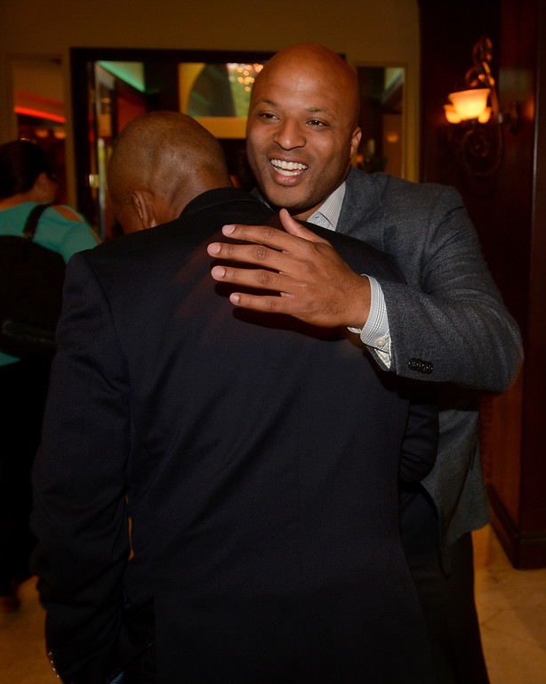 . Long Beach mayoral candidate Damon Dunn hugs Solomon Moore, of Long Beach, as he greets gust at The Grand Long Beach Event Center in Long Beach, CA. Tuesday June 3, 2014. (Thomas R. Cordova-Daily Breeze/Press-Telegram)