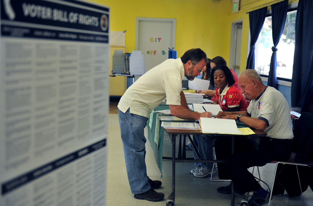 . Voters sign in for double voting duty Tuesday morning at El Dorado Park.  Long Beach June 3, 2014. (Photo by Brittany Murray / Daily Breeze)