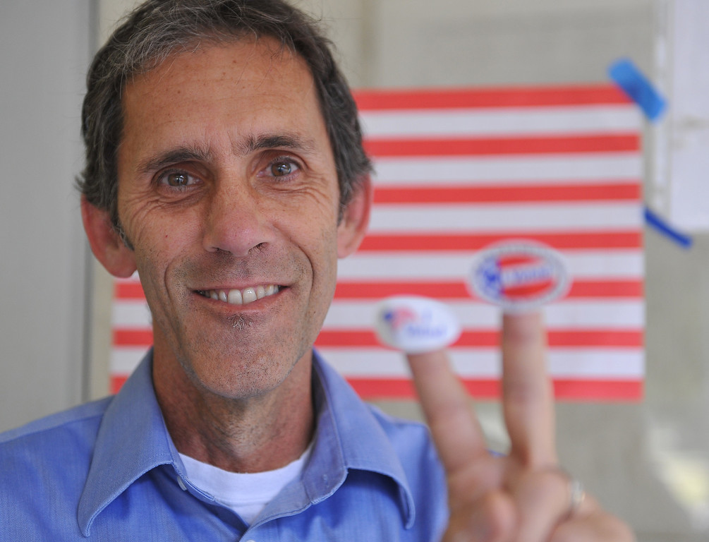 """. Joseph Godsil has double \""""I voted,\"""" stickers to fluant Tuesday morning after doing his civil duty at El Dorado Park.  Long Beach June 3, 2014. (Photo by Brittany Murray / Daily Breeze)"""