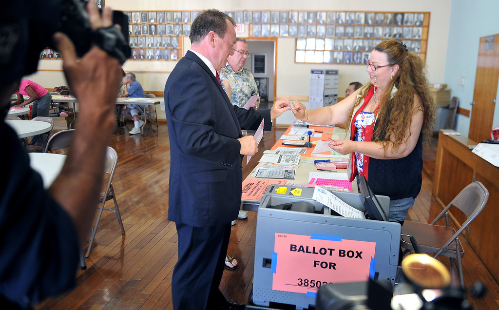 . Long Beach Police Chief and Sheriff candidate Jim McDonnell accompanied by his wife Kathy and daughters Megan and Kelly cast their votes at International City Masonic Temple on Tuesday morning in Long Beach. Long Beach June 3, 2014. (Photo by Brittany Murray / Daily Breeze)