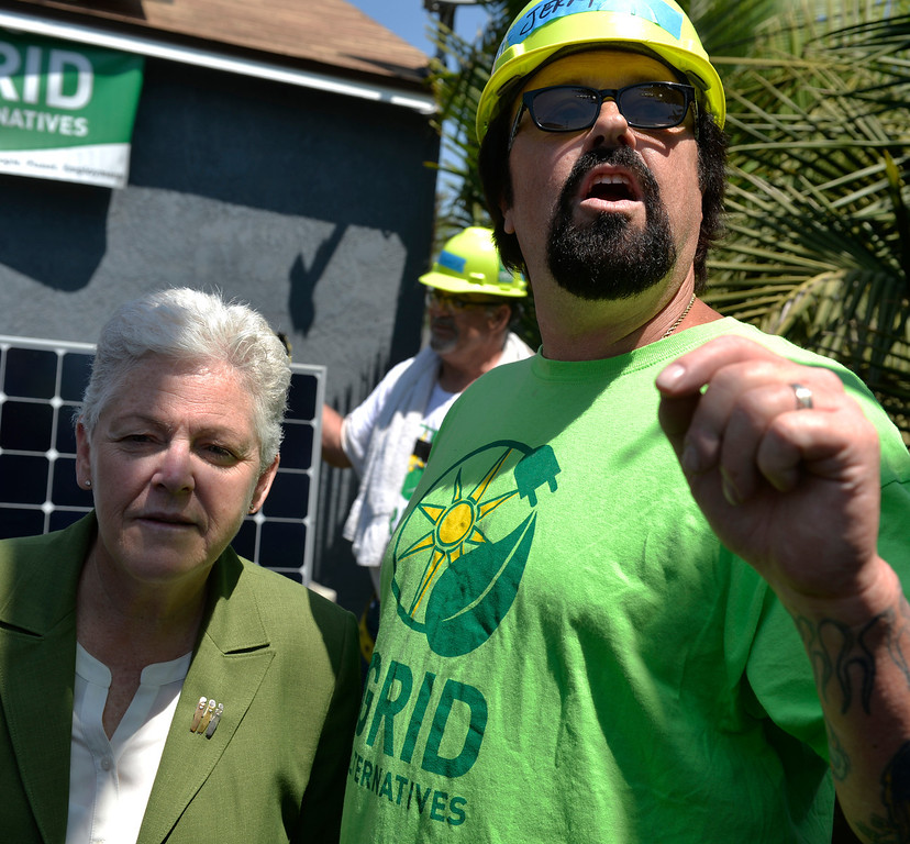 . Jerry Shumate, who is disabled from a car crash and battling Leukemia,  stands next to Gina McCarthy, administrator for the U.S. Environmental Protection Agency, as a free 2.8kW solar power system installed on his home in Long Beach, CA. Friday June 13, 2014. The system was installed by students from Los Angeles Trade Technical College�s Solar PV Technician certificate program. The college is partnering with GRID Alternatives, a non-profit group that provides job trainees with hands on experience and low-income families with lower energy bills. After installation, the energy system will supply between 75 and 90 percent of Shumate\'s home energy needs (Thomas R. Cordova-Daily Breeze/Press-Telegram)