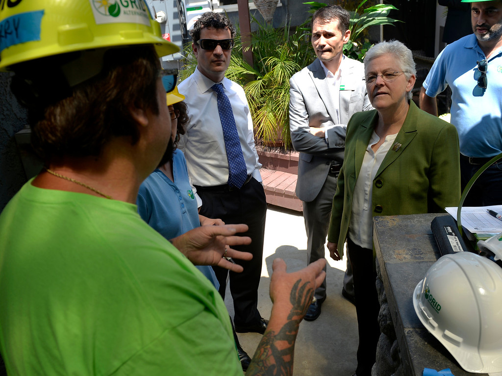 . Jerry Shumate, who is disabled from a car crash and battling Leukemia left,  talks to Gina McCarthy, administrator for the U.S. Environmental Protection Agency right, as a free 2.8kW solar power system installed on his home in Long Beach, CA. Friday June 13, 2014. The system was installed by students from Los Angeles Trade Technical College�s Solar PV Technician certificate program. The college is partnering with GRID Alternatives, a non-profit group that provides job trainees with hands on experience and low-income families with lower energy bills. After installation, the energy system will supply between 75 and 90 percent of Shumate\'s home energy needs (Thomas R. Cordova-Daily Breeze/Press-Telegram)