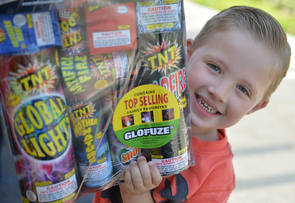 . The calm before the storm on Wednesday afternoon at the Lakewood YMCA fireworks stand. Safe and Sane fireworks are legal in Lakewood and the stands will likely be very busy the next two days. Owen Manel, 4, says all the fireworks are his favorite.  Long Beach July 2, 2014.  (Photo by Brittany Murray / Daily Breeze)