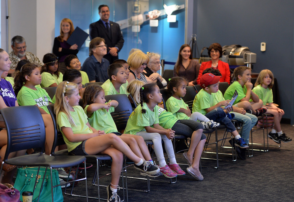 . Students from the Sunrise Child Development Center in Garden Grove listen to a presentation at the Columbia Memorial Space Center in Downey to celebrate their  partnership with the Google Cultural Institute. The partnership makes a selection of images, ranging from space shuttles built when the city was home to vast aerospace manufacturing facilities to their state of the art learning center visited by thousands of students each year, accessible to a global audience. Long Beach August 7, 2014. (Photo by Brittany Murray / Daily Breeze)