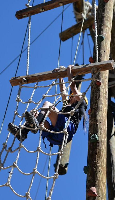. Young girls progressing up the Alpine Climb, learning trust, teamwork and gaining self confidence. The kids are enjoying the mountains for a week at Camp River Glen, a much different environment than their usual inner city home lives across Southern California. August 6, 2014. (Photo by Brittany Murray / Daily Breeze)