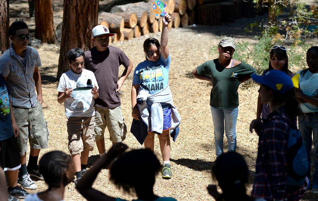 . Kourtney Gribble, 10, of Long Beach center, playing a game while waiting for lunch. The kids are enjoying the mountains for a week at Camp River Glen, a much different environment than their usual inner city home lives across Southern California. August 6, 2014. (Photo by Brittany Murray / Daily Breeze)
