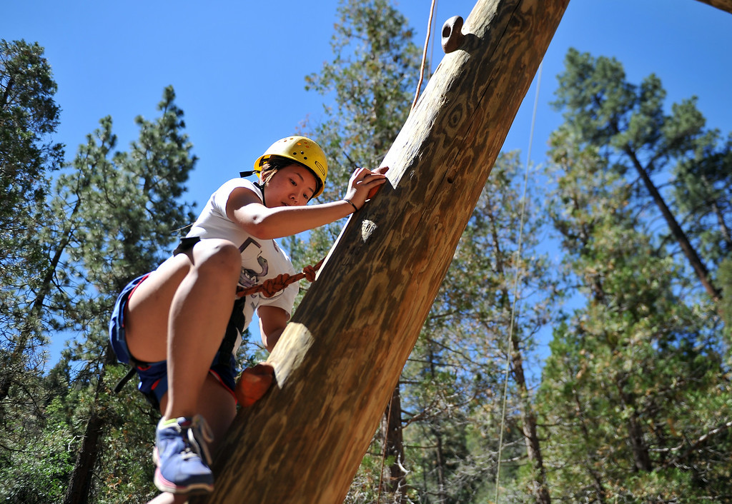 . Carol Chung, 15,  progressing up the Alpine Climb, learning trust, teamwork and gaining self confidence. The kids are enjoying the mountains for a week at Camp River Glen, a much different environment than their usual inner city home lives across Southern California. August 6, 2014. (Photo by Brittany Murray / Daily Breeze)