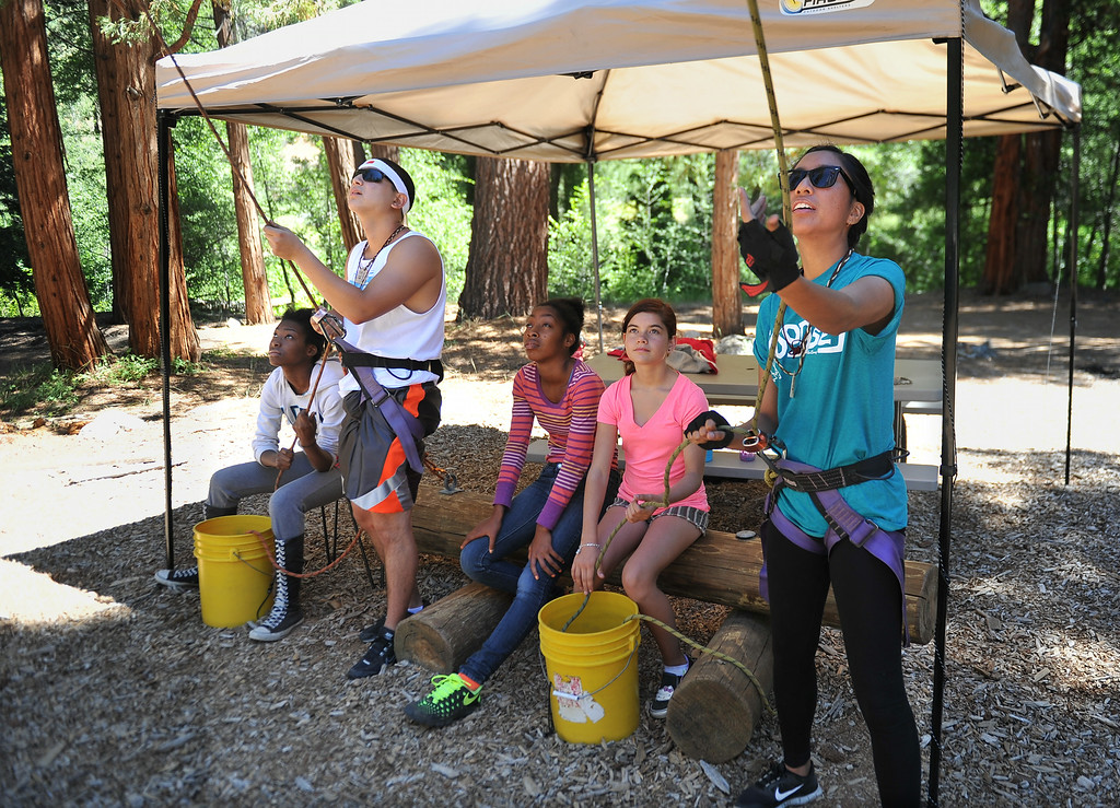 . Counselors hold the ropes at the Alpine Climb, while campers do the climbing and learn trust, teamwork and gain self confidence. The kids are enjoying the mountains for a week at Camp River Glen, a much different environment than their usual inner city home lives across Southern California. August 6, 2014. (Photo by Brittany Murray / Daily Breeze)