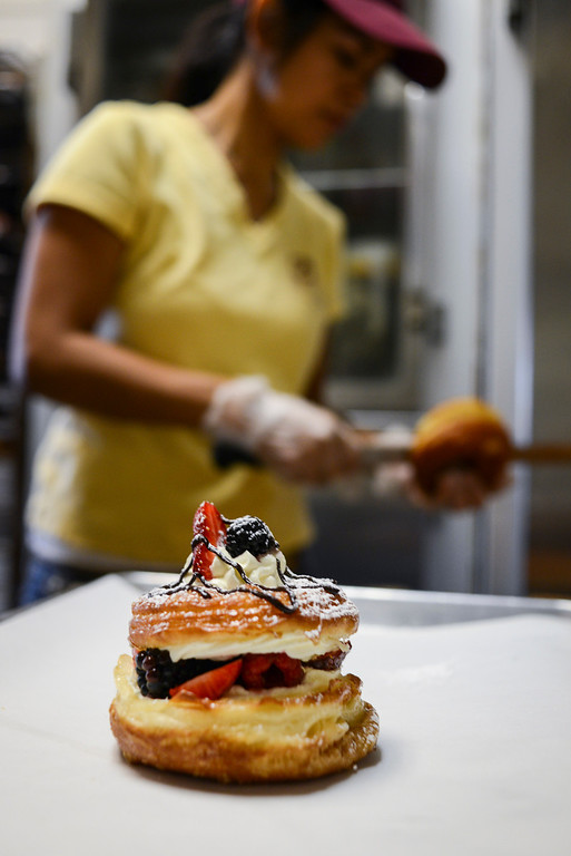 """. Cindy Seam creates her \""""doughssants\"""" in her Spudnuts doughnut shop in Canoga Park.  The latest food fad is made from a combination of doughnuts and croissants with lots of cream and other tasty ingredients.   Photo by David Crane/Los Angeles Daily News."""