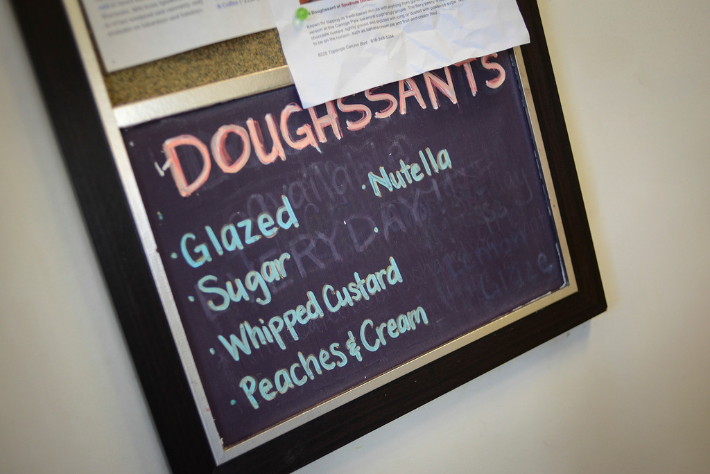 """. Cindy Seam creates \""""doughssants\"""" in her Spudnuts doughnut shop in Canoga Park.  The latest food fad is made from a combination of doughnuts and croissants with lots of cream and other tasty ingredients.   Photo by David Crane/Los Angeles Daily News."""