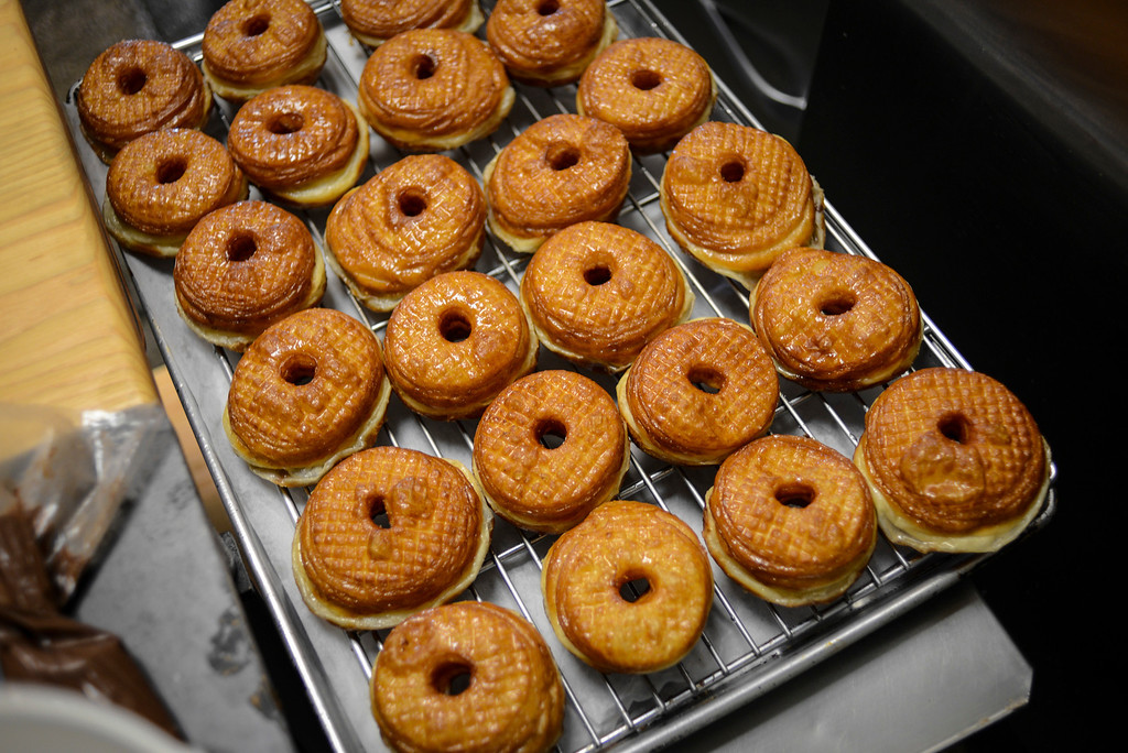 """. \""""doughssants\"""" are made like doughnuts but using croissant flour.  The latest food fad is made from a combination of doughnuts and croissants with lots of cream and other tasty ingredients.   Photo by David Crane/Los Angeles Daily News."""