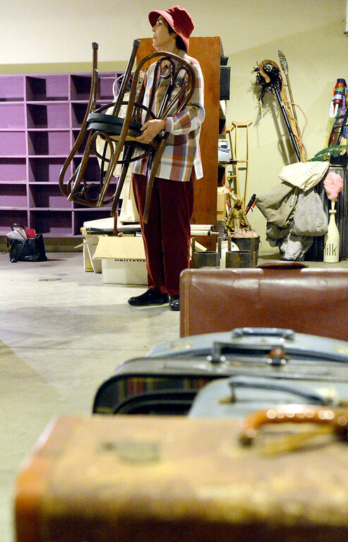 . Marsha Moode, Executive Producer of Downey Civic Light Opera, moves a pair of chairs while in the basement of the Downey Theater as she sales stage and theater items of the opera group in Downey Thursday September 12, 2013. The Downey Civic Light Opera is closing after 58 years. (Photo by Thomas R. Cordova/ Daily Breeze)
