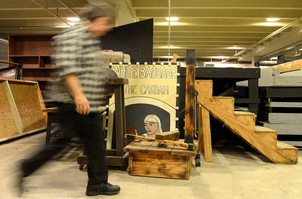 . Sally Casey Bell, of Downey Civic Light Opera, walks by props of past productions in the basement of the Downey Theater of the opera group in Downey Thursday September 12, 2013. The Downey Civic Light Opera is closing after 58 years. (Photo by Thomas R. Cordova/ Daily Breeze)