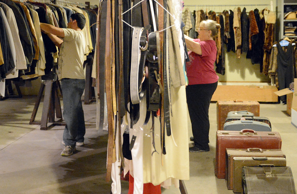 . Yolanda Rowell, of a Fullerton theater group, looks to buy theater and stage items from the Downey Civic Light Opera at the Downey Theater in Downey Thursday September 12, 2013. The Downey Civic Light Opera is closing after 58 years. (Photo by Thomas R. Cordova/ Daily Breeze)