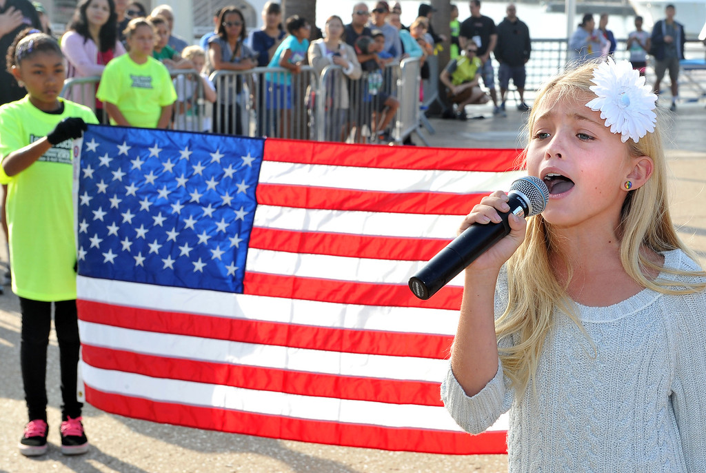 . 10/12/13 - Quinn Roldan, 9, of Huntington Beach sings the National Anthem at the start  of The Aquarium of the Pacific Kids Fun Run the day before the Long Beach International City Bank marathon & half marathon. (Photo by Brittany Murray/Press Telegram)