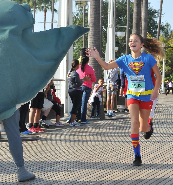 . 10/12/13 - Nicole Stall, 12, of Newberry Park, approaches the finish line at The Aquarium of the Pacific Kids Fun Run the day before the Long Beach International City Bank marathon & half marathon. (Photo by Brittany Murray/Press Telegram)