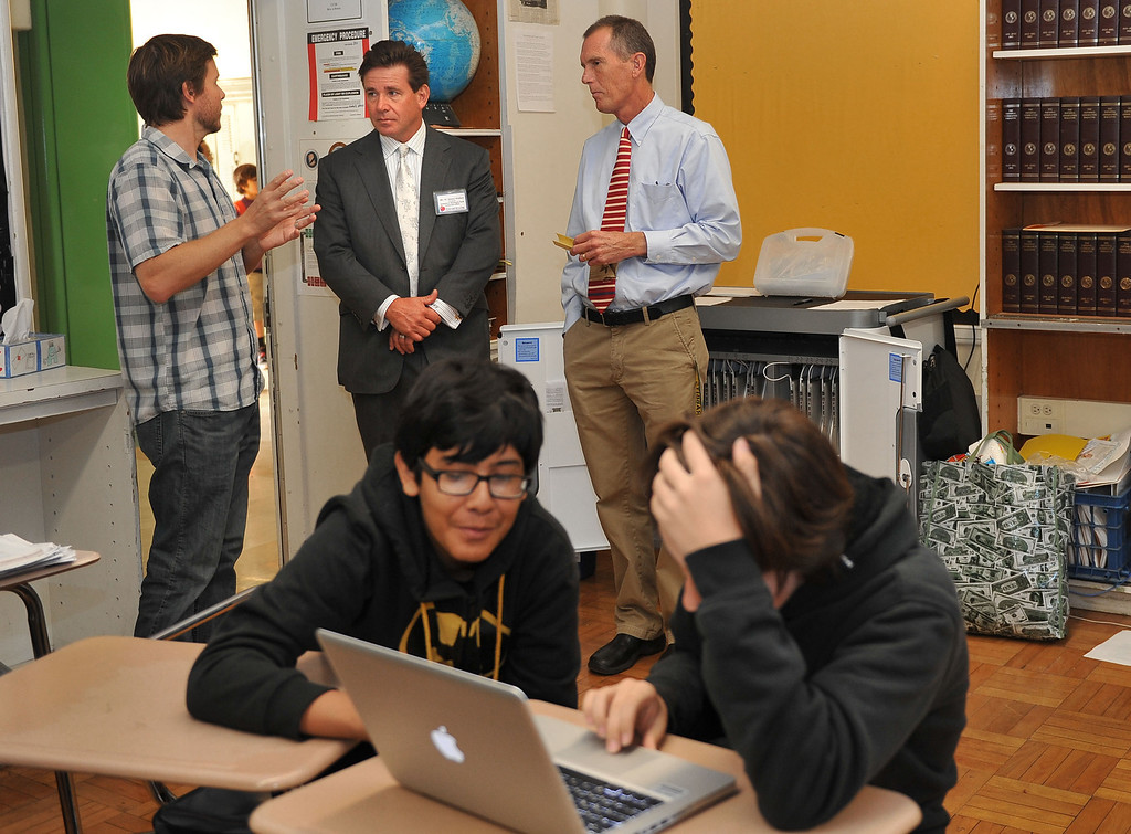 ". 10/16/13 - L-R Jeff Montooth, teacher,  co-pricnicpal Joe Carlson and President of Farmers and Merchants Bank, Henry Walker, observe a classroom at Poly High School on Wednesday morning. Walker was participating in ""Principal for a Day,\"" an event that brings community members from the Greater Long Beach Area into schools in the role of the principal. It is co-sponsored by the Long Beach Area Chamber of Commerce, the Long Beach Unified School District and the Long Beach Education Foundation. (Photo by Brittany Murray/Press Telegram)"