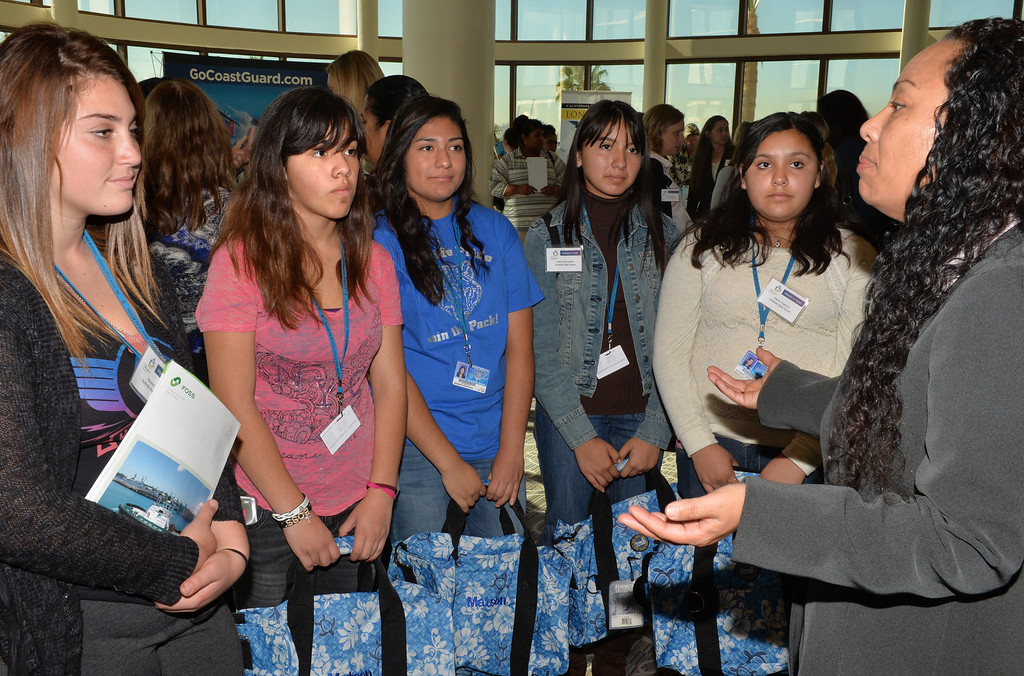 . Mitchie Logan, director of customer service for API, talks with McBride High School students at the 2013 Celebrating Women in Trade luncheon in Long Beach on November 14. This is the third event to recognize the important role women play in the field of goods movement and to inspire young women in high school to envision a career in the industry.(Photo by Brittany Murray/ Press Telegram)