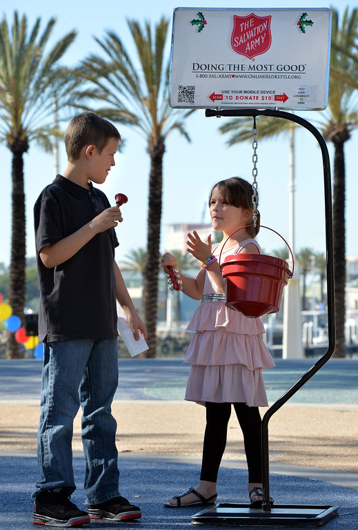 . L-R Anthony Reedy, 12, and Katie Reedy, 7, ring the bell at the Salvation Army kettle kick off event Long Beach, November 30, 2013. (Photo by Brittany Murray / Press Telegram)