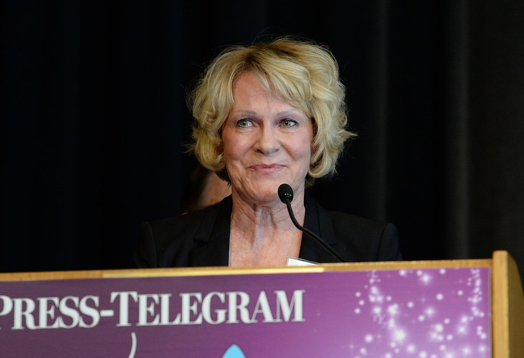 . Gina Rushing Maguire accepts the award for the Education category  at the Press Telegram Amazing Women 2013 Gala in Lakewood, CA. on Wednesday, November 13, 2013. (Photo by Sean Hiller/Press Telegram).